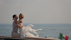 bride and groom kissing on the boat - stock footage