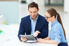 Discussion between male and female colleagues Stock Photos