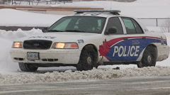 Police at scene of car accident and crash scene in snowstorm Stock Footage