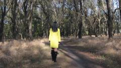 Beautiful slender girl in coat with long hair Stock Footage