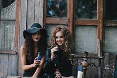 Two vintage witches perform magic ritual Stock Photos