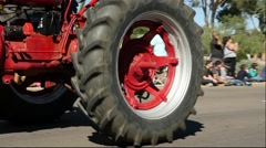 Old Farm Tractor in a Parade - stock footage