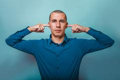 a  man of European  appearance thirty years his ears fingers on - stock photo