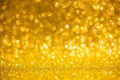 Golden glitter christmas abstract background. Shiny golden lights - stock photo