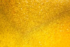 Golden glitter christmas abstract background. Shiny golden lights - stock photo