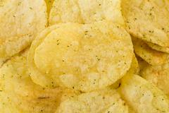 Prepared potato chips snack closeup view Stock Photos