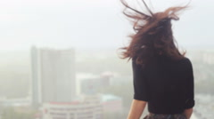 Young girl enjoys rain and sad at the roof Stock Footage