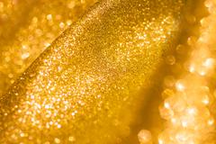 Stock Photo of Golden glitter christmas abstract background. Shiny golden lights