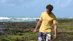 Man exploring tropical coastal reef Stock Footage