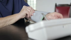 Senior women testing blood pressure and transmit data Stock Footage