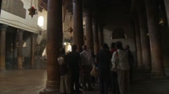 Bethlehem Church of the Nativity, track shot to pilgrim tourist group Stock Footage