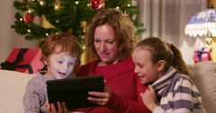 Family Online Searching For The Christmas Presents Stock Footage