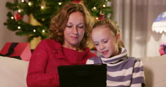 Mother And Daughter Browsing Internet On X-Mas - stock footage