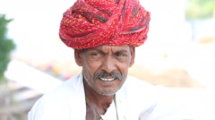 Portrait of an Indian man in a turban. Pushkar, Rajasthan, India Stock Footage