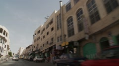 Driving up Palestinian town street towards Bethlehem centre Stock Footage