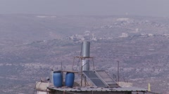 Israel - Palestine West Bank border landscape and roof in foreground, Ramallah Stock Footage