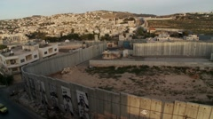 Israeli West Bank barrier wall at Bethlehem, pan right Stock Footage