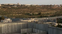 Stock Video Footage of West Bank separation barrier wall at Bethlehem, wide shot pan left