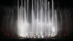 Colored water dancing fountain show at night Stock Footage