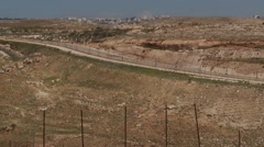 Israel border fence & security road, West Bank - no man's land - stock footage