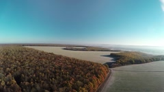 Aerial:flight over autumn woods and fields Stock Footage
