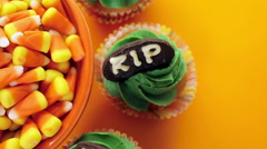 Stock Video Footage of Cupcakes with green icing prepared as Halloween treats.