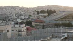 Israeli West Bank separation wall, Bethlehem, zoom out at sunset - stock footage