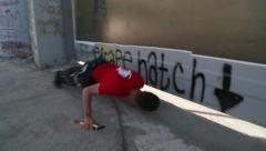 Israeli West Bank separation wall, man looks under barrier - stock footage