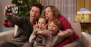 Stock Video Footage of Happy Family Showing Tongues To Camera And Waving