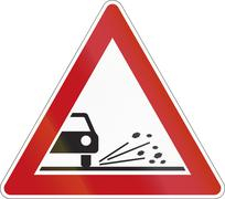 A road warning sign in Germany: Loose chippings Stock Illustration