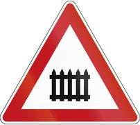A road warning sign in Germany: Level crossing with barrier Piirros