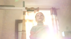 Sport little kid girl home in morning sun light haze jump catch horizontal bar Stock Footage
