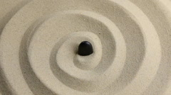 Approximation of black  stone on the sand Stock Footage