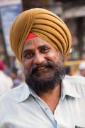 Portrait of indian man during Guru Nanak Gurpurab celebration in Delhi, India - stock photo