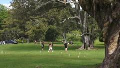 Young people play Croquet in Cornwall park Auckland New Zealand - stock footage