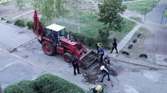 Repair crews repair the road and put new asphalt Stock Footage