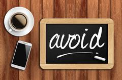 Stock Photo of coffee, phone  and chalkboard with  word avoid