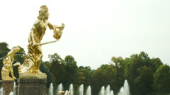 Golden statue of Perseus with Medusa's head in Peterhof Russia Stock Footage