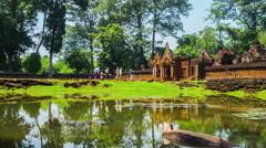 Tourists walking to Prasat Banteay Srei Stock Footage