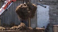 Forklift lowers manure onto the tractor trailer Stock Footage