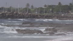 Close up shot of waves breaking over rocks Stock Footage