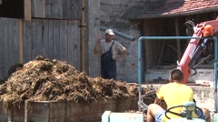 Filling the trailer with manure Stock Footage