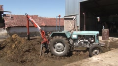 Stockpiling manure in the rural farm Stock Footage
