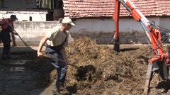 Piling up livestock manure Stock Footage