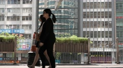 HONG KONG - People in business district passing by during lunch break. 4K Stock Footage