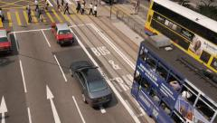 HONG KONG - October 2015: Street view with trams, traffic and people. 4K Stock Footage