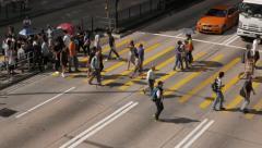 HONG KONG - October 2015: People on crosswalk in Kowloon. 4K resolution Stock Footage
