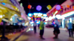 Tourists walking to and fro in the night Stock Footage