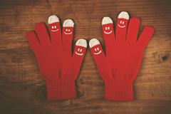 Christmas winter wool gloves with smiley emoticons Stock Photos