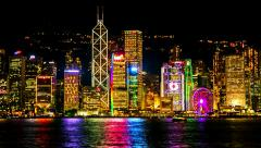 HONG KONG - October 2015: Night city view with boats and glowing skyscrapers. 4K - stock footage